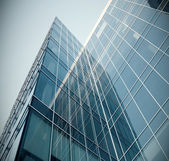 Modern blue glass skyscraper perspective view — Stock Photo