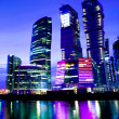 Night city of business skyscrapers in vibrant colors - Stock Photo
