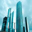 Glass skyscrapers in gale - Stock Photo