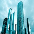 Glass skyscrapers in gale — Stock Photo