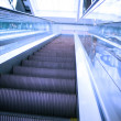 Motion of vanishing escalator in shopping mall - Stock Photo