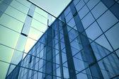 Modern blue glass skyscraper perspective view — Stock Photo