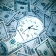 Stock Photo: Clock and money