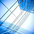Stock Photo: Blue glass wall of skyscraper perspective view