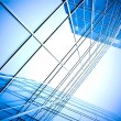 Blue glass wall of skyscraper perspective view — Stock Photo
