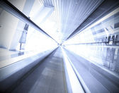 Moving escalator in office center — Stock Photo