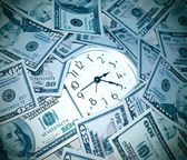 Clock and money — Stock Photo