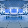 Royalty-Free Stock Photo: Contemporary blue lounge with seats in the airport