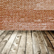 Red brick wall and wooden floor, rural interior — Stock Photo #6710820