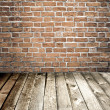 Red brick wall and wooden floor, rural interior — Stock Photo #6710851