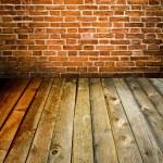 Abstract brick wall and wood floor — Stock Photo
