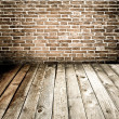 Abstract brick wall and wood floor — ストック写真