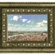 View over the red european roofs in beautiful vintage frame — Stock Photo