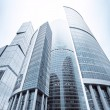 Futuristic structure of office skyscrapers in the morning - Stock Photo