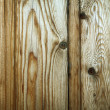 Close-up of fragment of wooden surface of brown color with visible texture — Stock Photo #6711308