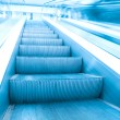 Blue escalator in business hall — Stock Photo