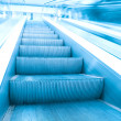 Blue escalator in business hall — Stock Photo #6711560