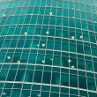 Green transparent glass wall of office building — Stock Photo