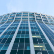 Transparent glass wall of office building — Stock Photo #6711844