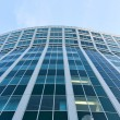 Transparent glass wall of office building - Stock Photo
