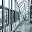 Stockfoto: Glazed corridor in office center