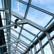 Structure of modern glass limpid ceiling inside shopping mall — Stock Photo #6711922