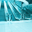 Stock Photo: Motion of blue vanishing escalator