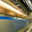 Vanishing colorful high-speed train in motion — Stock Photo