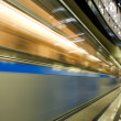 Stock Photo: Vanishing colorful high-speed train in motion