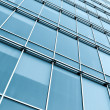 Blue glass wall of modern building — Stock Photo