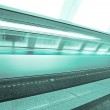 Fast moving train on underground platform — Stock Photo #6712402
