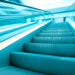 Angle view to modern green steps of moving business escalator — Stock Photo #6712521