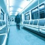 Moving silhouettes inside illuminated carriage — Stock Photo #6712545