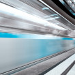 Blue fast train in motion — Stock Photo