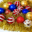 Vivid yellow garland with colorful balls - Stock Photo