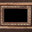 Vintage metal frame over fabric texture — Stock Photo