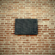 Black blank marble signboard close-up over wall — Stock Photo