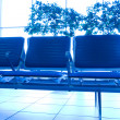 Contemporary blue lounge with seats in the airport — Stock Photo #6712949