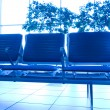 Contemporary blue lounge with seats in the airport — Stock Photo