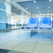 Contemporary blue lounge with seats in the airport — Stock Photo #6712967