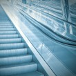 Moving escalator in airport — Stock Photo #6713085