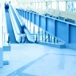 Blue modern escalator in business center - Stock Photo