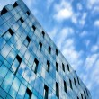 Modern glass side of office building in business center - Stock Photo