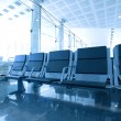 Contemporary blue lounge with seats in the airport — Stock Photo #6713678