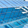 Transparent glass wall of office building — Stock Photo #6713736