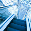 Blue escalator in motion - Photo