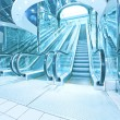 Contemporary moving escalator stairs inside business blue hall - Photo