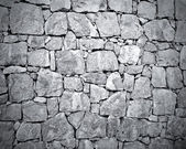 Dark stone wall texture — Stockfoto