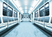 Blue contemporary illuminated carriage interior — Stock Photo
