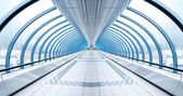 Endless vanishing walkway with transparent wall in cool business — Stock Photo